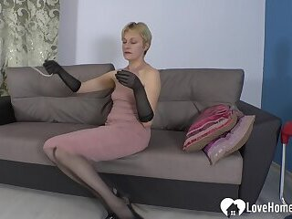 Seductive office babe uses a sex toy