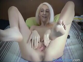 a cute blonde spreads her pussy for us