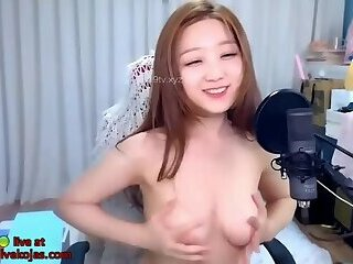 Asian lovely camgirl camgirl plays her boobs