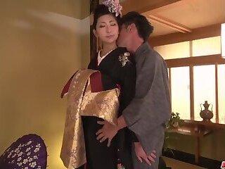 Milf takes down her kimono for a big dick