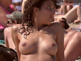 Sexy girls go Topless on the Beach Voyeur Public